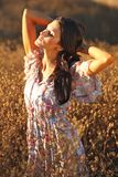 Beautiful Woman on a Field in Summertime Royalty Free Stock Photography