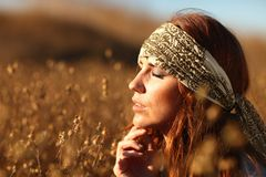 Beautiful Woman on a Field in Summertime Stock Photography