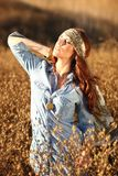 Beautiful Woman on a Field in Summertime Stock Image