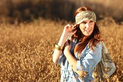 Beautiful Woman on a Field in Summertime Royalty Free Stock Image