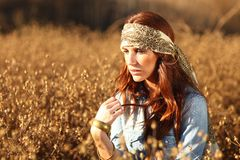 Beautiful Woman on a Field in Summertime Stock Photo