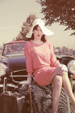 Beautiful woman in fifties style, road trip. Young beautiful woman in fifties style on the road trip Stock Photography