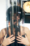 Beautiful woman with filmstrips hairstyle. Beautiful stylish woman with film hairstyle in leather corset posing in studio with filmstrip rolls Stock Photography