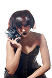 Beautiful woman with filmstrips hairstyle. Beautiful stylish woman in leather corset and filmstrip hairstyle posing with retro camera isolated on white Stock Photography