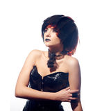 Beautiful woman with filmstrips hairstyle. Beautiful stylish woman in leather corset and filmstrips hairstyle posing isolated on white background Stock Photography