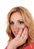 Beautiful woman with finger on face. Royalty Free Stock Images