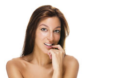 Beautiful woman with a finger at her mouth Stock Photography