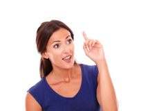 Beautiful woman with finger pointing up Royalty Free Stock Image