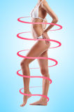Beautiful woman with fit body being in spirals Royalty Free Stock Photos