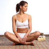 Beautiful woman fit body sitting cross legs Stock Image