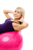 Beautiful woman with a fitness ball Royalty Free Stock Photography