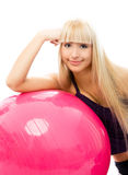 Beautiful woman with a fitness ball Royalty Free Stock Image