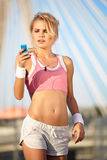 Beautiful woman during fitness on city Royalty Free Stock Photo