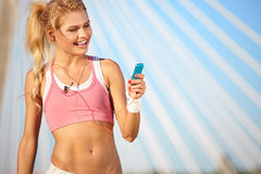 Beautiful woman during fitness on city Stock Photography