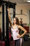 Beautiful woman in a fitness club Royalty Free Stock Photography