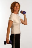 Beautiful woman in fitness gym royalty free stock photography