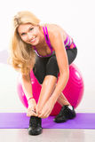 Beautiful woman fitness instructor sitting on stability ball Royalty Free Stock Photography