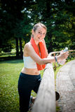 Beautiful woman fitness relaxing after sport Stock Images