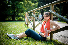 Beautiful woman fitness relaxing after sport Stock Photo