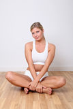 Beautiful woman in fitness room Royalty Free Stock Photos