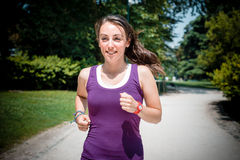 Beautiful woman fitness running Stock Images