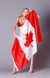 Beautiful woman with Flag of Canada. Stock Photo