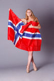 Beautiful woman with Flag of Norway. Royalty Free Stock Photo