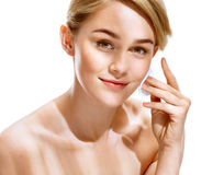 Beautiful woman with flawless skin is holding cotton pads near face. Stock Image
