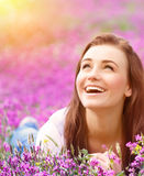 Beautiful woman on floral field Stock Images