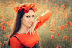 Beautiful Woman with Floral Wreath in a Field of Poppies Stock Photography