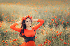 Beautiful Woman with Floral Wreath in a Field of Poppies Royalty Free Stock Images