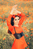 Beautiful Woman with Floral Wreath in a Field of Poppies Stock Image