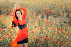 Beautiful Woman with Floral Wreath in a Field of Poppies Royalty Free Stock Photos