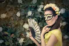 Beautiful Woman with Floral Wreath, Mask and Fan Stock Photography