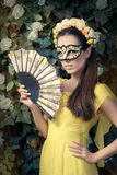 Beautiful Woman with Floral Wreath, Mask and Fan Royalty Free Stock Images