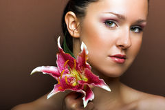 Beautiful woman with a flower Stock Photography
