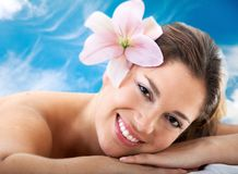 Beautiful woman with a flower Stock Images
