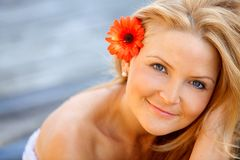 Beautiful woman with a flower Royalty Free Stock Photography