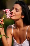 Beautiful woman with flower Stock Images