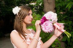 Beautiful woman with flower bouquet Royalty Free Stock Image