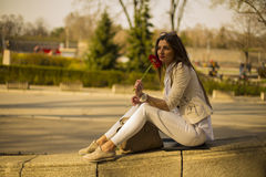 Beautiful woman with a flower in the city Stock Photos