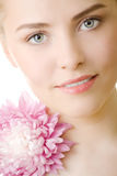 Beautiful woman with flower closeup isolated Stock Images