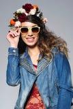 Beautiful woman in flower crown wearing sunglasses Stock Photos