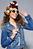 Beautiful woman in flower crown wearing sunglasses Royalty Free Stock Photo