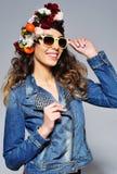 Beautiful woman in flower crown wearing sunglasses Royalty Free Stock Photo