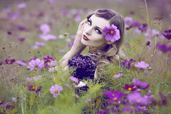 Beautiful woman in a flower field Stock Photos
