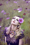 Beautiful woman in flower field Royalty Free Stock Photography
