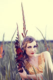 Beautiful woman in a flower field Royalty Free Stock Photos