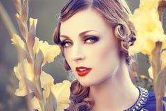 Beautiful woman in a flower field royalty free stock photo