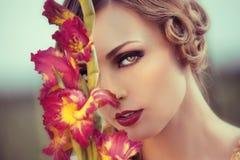 Beautiful woman in a flower field Stock Photo